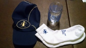 Cap, socks, and beer glass.