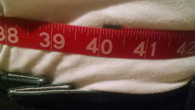 Measuring tape shoing 40 inches around the waist.
